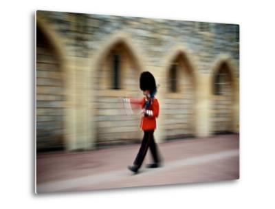 A Queen's Guard with a Rifle Walking Outside Windsor Castle-Heather Perry-Metal Print