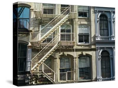 Fire Escapes on Buildings in Soho-Kike Calvo-Stretched Canvas Print