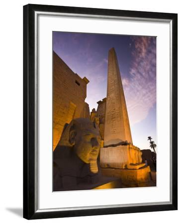 An Obelisk and Sphinx Head at the Entrance to Luxor Temple-Michael Melford-Framed Photographic Print