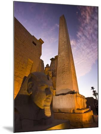 An Obelisk and Sphinx Head at the Entrance to Luxor Temple-Michael Melford-Mounted Photographic Print