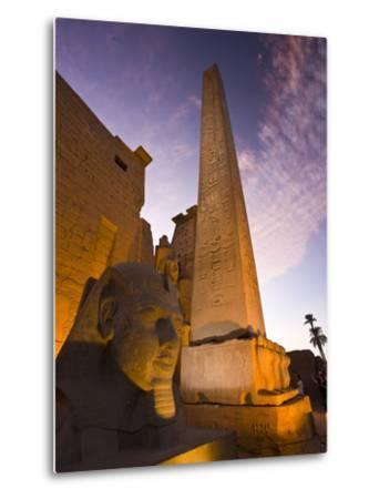 An Obelisk and Sphinx Head at the Entrance to Luxor Temple-Michael Melford-Metal Print