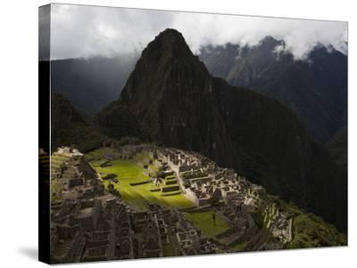 Sunlight Strikes Machu Picchu Through a Break in the Clouds-Michael Melford-Stretched Canvas Print