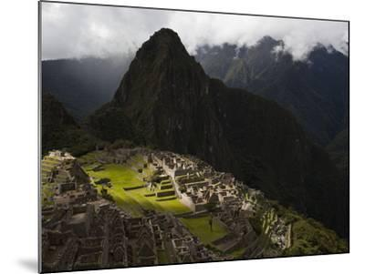 Sunlight Strikes Machu Picchu Through a Break in the Clouds-Michael Melford-Mounted Photographic Print