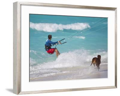 A Kiteboarder and His Dog Enjoying Gusty Winds from Hurricane Tomas-Mike Theiss-Framed Photographic Print