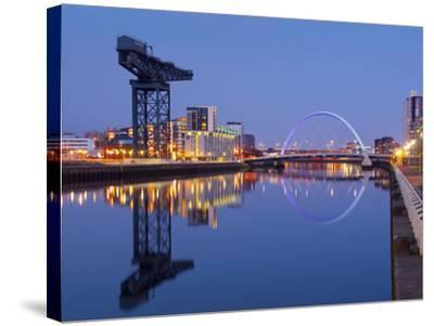 UK, Scotland, Glasgow, River Clyde, Finnieston Crane and the Clyde Arc, Nicknamed the Squinty Bridg-Alan Copson-Stretched Canvas Print