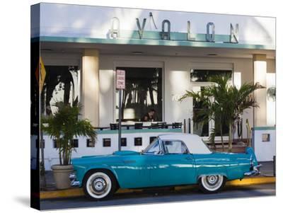 USA, Miami Beach, South Beach, Ocean Drive, Avalon Hotel and 1957 Thunderbird Car-Walter Bibikow-Stretched Canvas Print