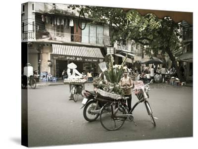 Flower Seller in the Old Quarter, Hanoi, Vietnam-Jon Arnold-Stretched Canvas Print