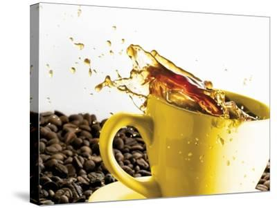 Coffee Spilling Out of a Cup-Dieter Heinemann-Stretched Canvas Print