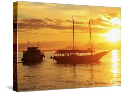 Brazil, Rio De Janeiro State, Angra Dos Reis, Ilha Grande, Fishing Boat and Schooner Silhouetted-Alex Robinson-Stretched Canvas Print