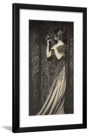 Muse Staring at Black Ball--Framed Art Print