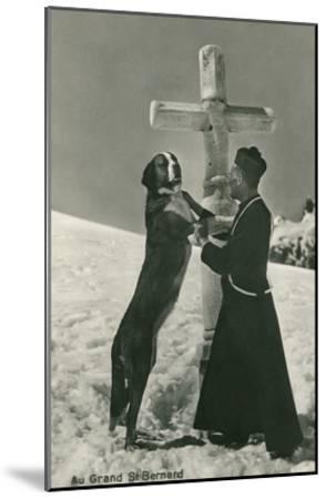St. Bernard Dog Wtih Priest at Cross--Mounted Art Print