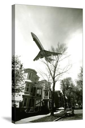Airliner Above Residential Area--Stretched Canvas Print