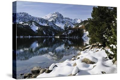 St. Maurici Lake and Snowy Peaks of Aigues Tortes Nat'l Park in Winter, Pyrenees, Catalonia, Spain-Nick Upton-Stretched Canvas Print