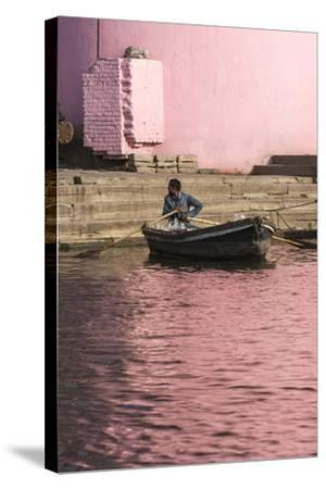A Man in a Rowboat in Water Tinted Pink by Reflections of a Pink Wall-Jonathan Irish-Stretched Canvas Print