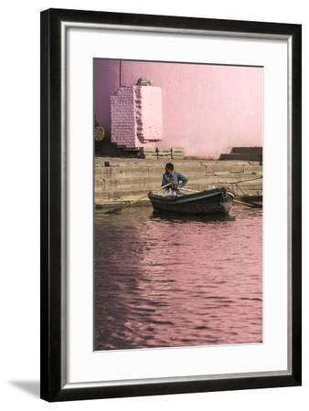 A Man in a Rowboat in Water Tinted Pink by Reflections of a Pink Wall-Jonathan Irish-Framed Photographic Print