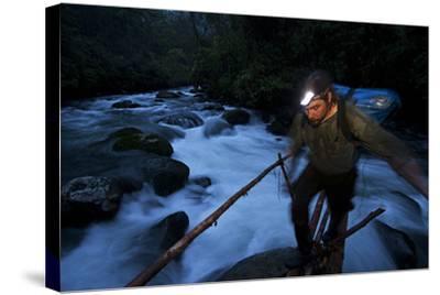 A Birds of Paradise Researcher Walks on a Pole and Vine Bridge-Tim Laman-Stretched Canvas Print