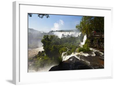 Tourists Stand on a Viewing Platform Overlooking Iguazu Falls-Ralph Lee Hopkins-Framed Photographic Print