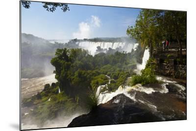 Tourists Stand on a Viewing Platform Overlooking Iguazu Falls-Ralph Lee Hopkins-Mounted Photographic Print