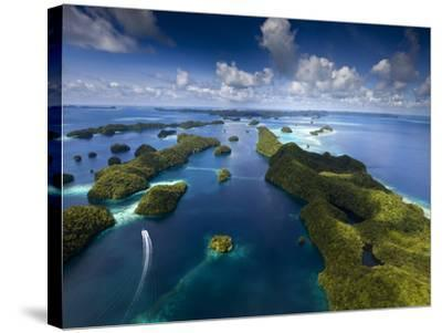 An Aerial View of a Boat as it Speeds Through the Rock Islands, Republic of Palau.-Ian Shive-Stretched Canvas Print