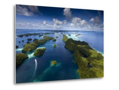 An Aerial View of a Boat as it Speeds Through the Rock Islands, Republic of Palau.-Ian Shive-Metal Print