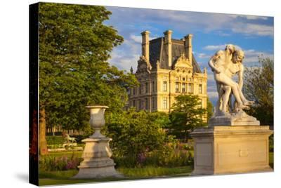 Statue in Jardin Des Tuileries with Musee Du Louvre Beyond, Paris, France-Brian Jannsen-Stretched Canvas Print