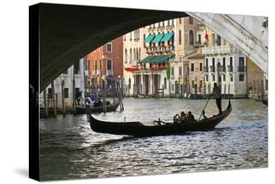 Tourist in a Gondola as They Pass under the Rialto Bridge, Venice, Italy-David Noyes-Stretched Canvas Print