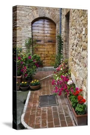 Doorway with Flowers, Pienza, Tuscany, Italy-Terry Eggers-Stretched Canvas Print