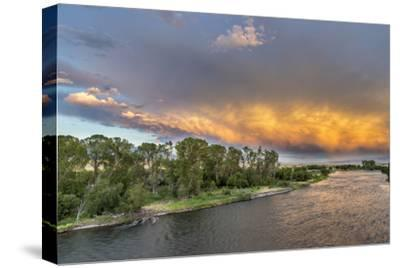 Incredible Stormy Light on the Madison River at Sunset Near Ennis, Montana, USA-Chuck Haney-Stretched Canvas Print