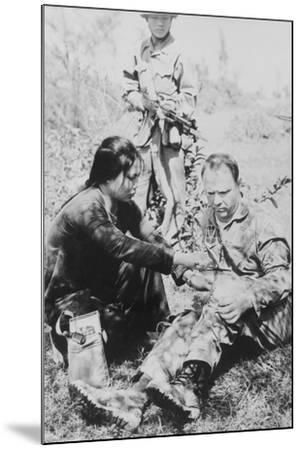 US Air Force Pilot Is Given First Aid by North Vietnam Captors in Jan. 1966--Mounted Photo