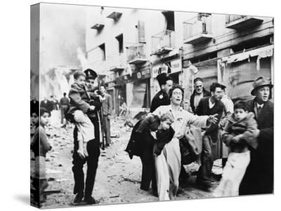 Family Fleeing from the Jewish District of Jerusalem, after a Bomb Blast, Feb. 1948--Stretched Canvas Print