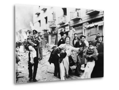 Family Fleeing from the Jewish District of Jerusalem, after a Bomb Blast, Feb. 1948--Metal Print