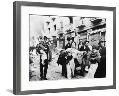 Family Fleeing from the Jewish District of Jerusalem, after a Bomb Blast, Feb. 1948--Framed Photo