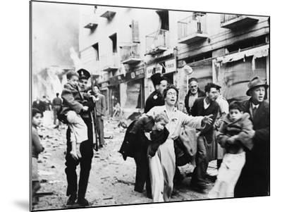 Family Fleeing from the Jewish District of Jerusalem, after a Bomb Blast, Feb. 1948--Mounted Photo