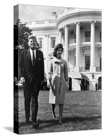 President and Mrs. John F. Kennedy Walking on the South Lawn of the White House on April 16, 1962--Stretched Canvas Print
