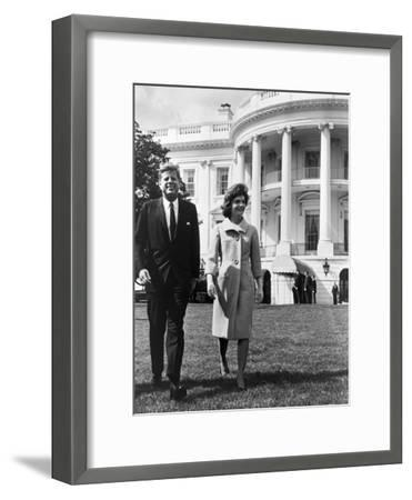 President and Mrs. John F. Kennedy Walking on the South Lawn of the White House on April 16, 1962--Framed Photo