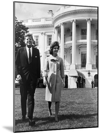 President and Mrs. John F. Kennedy Walking on the South Lawn of the White House on April 16, 1962--Mounted Photo