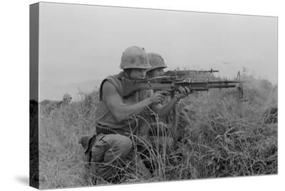US Marine Machine Gunner and Rifleman Fire at the Enemy, Near DMZ, Vietnam, 1967--Stretched Canvas Print