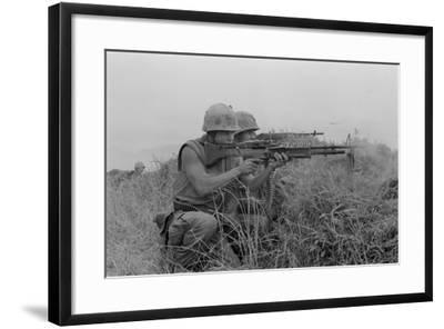 US Marine Machine Gunner and Rifleman Fire at the Enemy, Near DMZ, Vietnam, 1967--Framed Photo