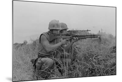 US Marine Machine Gunner and Rifleman Fire at the Enemy, Near DMZ, Vietnam, 1967--Mounted Photo