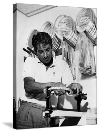 Richard 'Pancho' Gonzales Restringing a Tennis Racket in 1962--Stretched Canvas Print