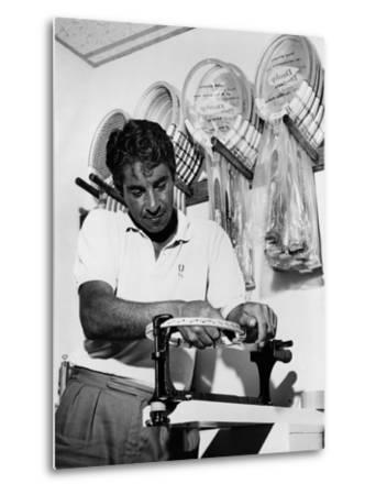 Richard 'Pancho' Gonzales Restringing a Tennis Racket in 1962--Metal Print