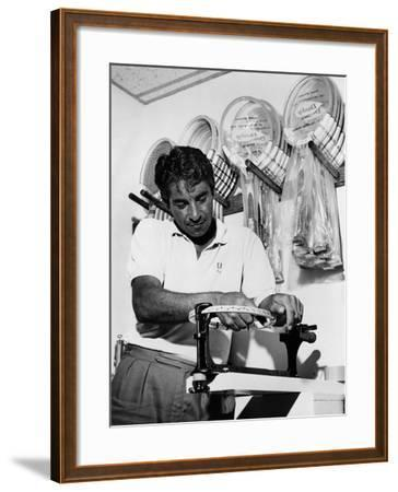 Richard 'Pancho' Gonzales Restringing a Tennis Racket in 1962--Framed Photo