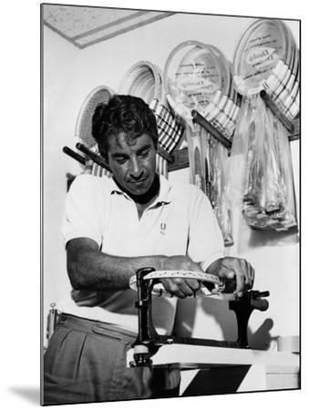 Richard 'Pancho' Gonzales Restringing a Tennis Racket in 1962--Mounted Photo