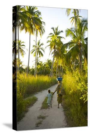 A Woman and Her Son Walking Between Fishing Villages On Matemo Island-Jad Davenport-Stretched Canvas Print
