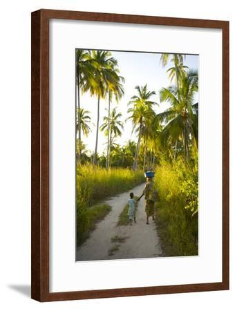 A Woman and Her Son Walking Between Fishing Villages On Matemo Island-Jad Davenport-Framed Photographic Print
