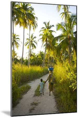 A Woman and Her Son Walking Between Fishing Villages On Matemo Island-Jad Davenport-Mounted Photographic Print