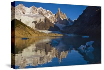 Adela and Cerro Torre Massifs Reflected in the Laguna Torre At Dawn-Beth Wald-Stretched Canvas Print