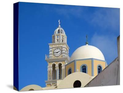 A Multi-colored Church On the Road Between Fira and Firostefani-Charles Kogod-Stretched Canvas Print