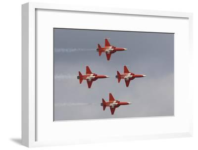 Bright Red Jets Flying in Formation At an Air Show-Joe Petersburger-Framed Photographic Print