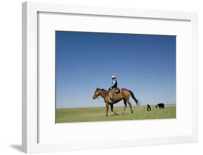 A Cowboy Rides His Horse On a Ranch Near Fort Pierre-Joel Sartore-Framed Photographic Print